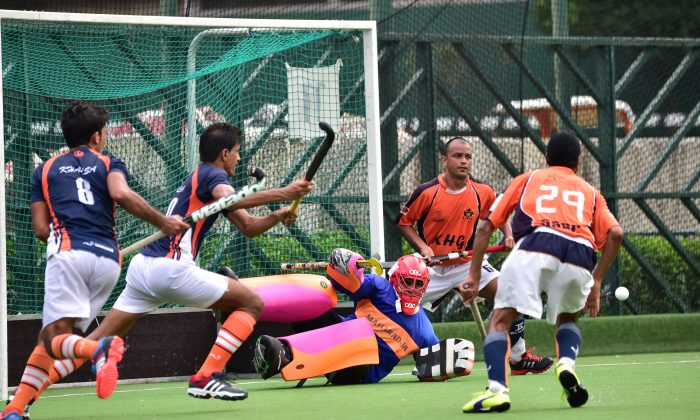 SSSC-A Goalie, Gurdeep Singh makes a fine save during the final of the Guru Nanak Cup Final against Khalsa-A at Happy Valley on Sunday Nov. 30, 2014. SSSC-A won an exciting final with a golden goal in extra time. (Bill Cox/Epoch Times)