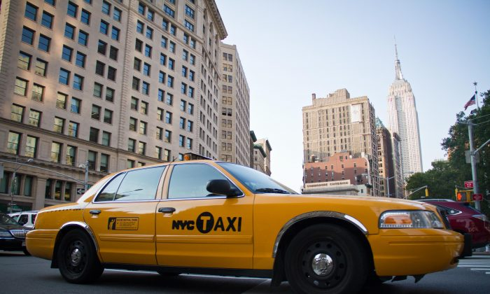 A taxi drives across 23rd Street in the Flat Iron District of Manhattan on July 7, 2012. (Benjamin Chasteen/Epoch Times