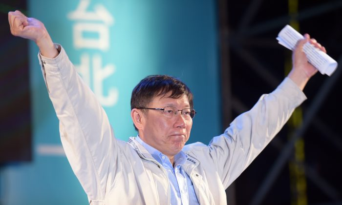 Newly-elected independent Taipei Mayor Ko Wen-je gestures after winning the mayoral election in Taipei on Nov. 29, 2014. Taiwan's warmer relations with China were called into question on Nov. 30 after the island's Beijing-friendly ruling party suffered a massive defeat at local elections. (Sam Yeh/AFP/Getty Images)