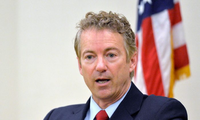 Sen. Rand Paul, R-Ky. speaks in Highland Heights, Ky., on Nov. 21, 2014. The presidential contest that's starting to take shape is exposing divisions among likely Republican candidates on the nation's role in global affairs. Among those outlining foreign policy this week: Bush, Rand Paul, Ted Cruz and Bobby Jindal, as well as the party's 2008 presidential nominee, Sen. John McCain. (AP Photo/Timothy D. Easley)