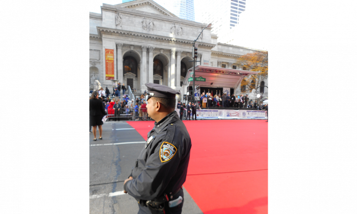 NYPD officer on post at Fifth Avenue and 41st Street during the Veterans Day Parade on Nov. 11, 2014. (Vincent J. Bove)