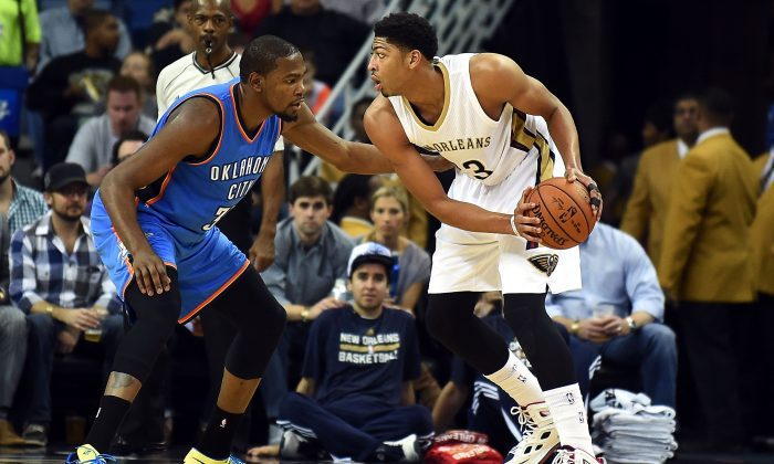 Anthony Davis #23 of the New Orleans Pelicans is defended by Kevin Durant #35 of the Oklahoma City Thunder during a game at the Smoothie King Center on December 2, 2014 in New Orleans, Louisiana. (Photo by Stacy Revere/Getty Images)