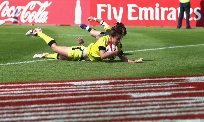 Chloe Dalton of Australia scores a try against South Africa during the IRB Women's Sevens Rugby World Series at the Emirates Dubai Rugby Sevens on December 4, 2014 in Dubai, United Arab Emirates. (Warren Little/Getty Images)