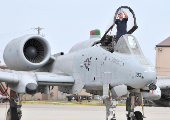 A US Air Force airman cleans the canopy of an A-10 Thunderbolt aircraft  April 14, 2009.  (KIM JAE-HWAN/AFP/Getty Images)
