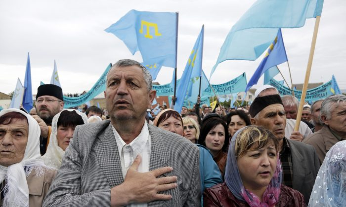 Crimean Tatars attend a memorial ceremony marking the 70th anniversary of the deportation of Tatars from Crimea, near a Mosque in Simferopol, on May 18, 2014. (Max Vetrov/AFP/Getty Images)