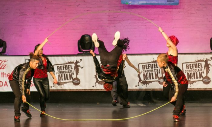 Team Altavista from Japan, performs in the 23rd Double Dutch Holiday Classic tournament at the Apollo Theater in Harlem, New York City on Dec. 7, 2014. (Benjamin Chasteen/Epoch Times)
