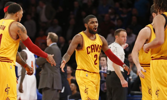 Cleveland Cavaliers guard Kyrie Irving (2) reacts while returning to the bench in the final minutes of the second half of an NBA basketball game against the New York Knicks in New York, Thursday, Dec. 4, 2014. The Cavaliers won 90-87. (AP Photo/Kathy Willens)