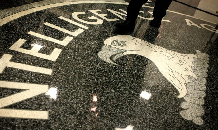 A man walks across the seal of the Central Intelligence Agency at the lobby of the Original Headquarters Building at the CIA headquarters February 19, 2009 in McLean, Virginia. (Alex Wong/Getty Images)