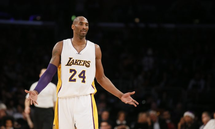 Los Angeles Lakers' Kobe Bryant reacts as he is called for an offensive foul against the New Orleans Pelicans during the second half of an NBA basketball game Sunday, Dec. 7, 2014, in Los Angeles. The Pelicans won 104-87. (AP Photo/Danny Moloshok)