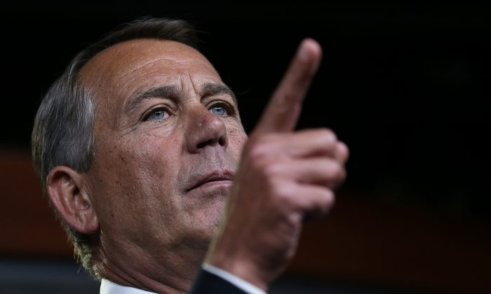 U.S. Speaker of the House John Boehner (R-Ohio) answers questions relating to the continued funding of the federal government during his weekly press conference on December 4, in Washington, D.C.(Win McNamee/Getty Images)