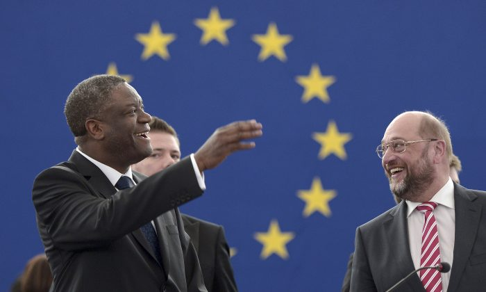 Congolese gynecologist, specialized in treating victims of rape and extreme sexual violence, Denis Mukwege (L), next to European Parliament President Martin Schulz after receiving the prestigious Sakharov human rights prize for his work in helping thousands of rape victims in the Democratic Republic of the Congo on Nov.26, 2014 at the European Parliament in Strasbourg, France. (Frederick Florin/AFP/Getty Images)