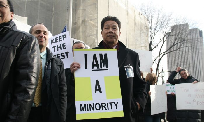 Phil Gim, 62, co-founder of a specialized high schools admissions exam advocacy group, on the steps of City Hall, Manhattan, N.Y. on Dec. 11, 2014. (Shannon Liao/Epoch Times)