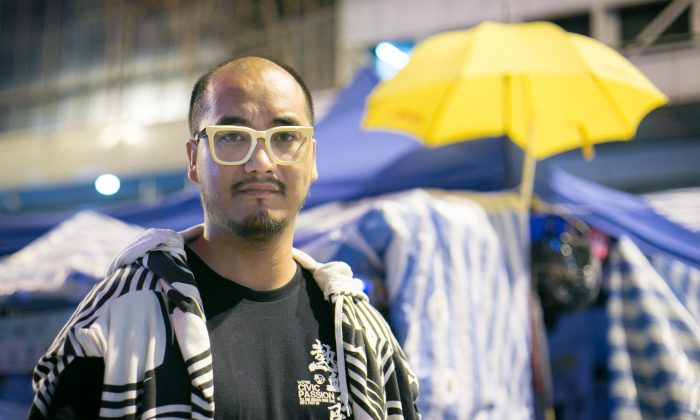Wong Yeung-tat, leader of the localist Hong Kong political group Civic Passion, was arrested on Dec. 11 on suspicion of participating in and inciting unlawful assembly. As the Umbrella Movement winds down in Hong Kong, supporters are worried that a new phase of political retaliation is setting in. (Benjamin Chasteen/Epoch Times)