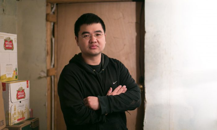 Jong-Min, 34, an undocumented immigrant who has been in the U.S. for most of his life, inside his family owned convenience store in Brooklyn, New York, on Dec. 8. 2014. Min is currently in the process of receiving a green card and wishes to go to law school. (Benjamin Chasteen/Epoch Times)