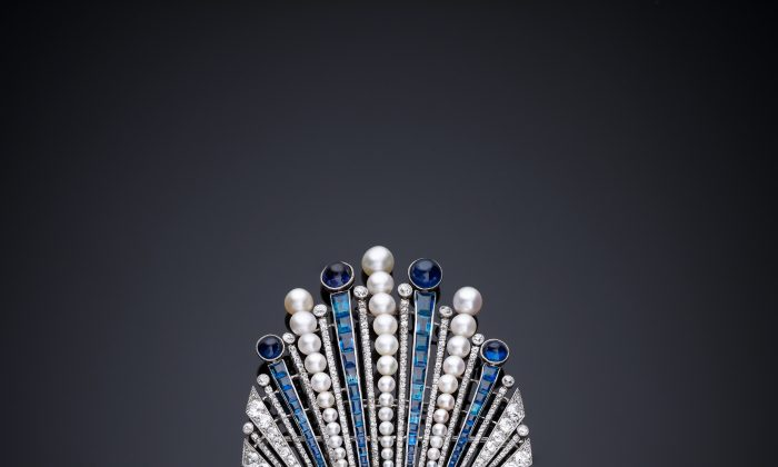 Aigrette designed by Paul Iribe, made by Robert Linzeler, Paris, 1910 in platinum set with emerald, sapphires, diamonds, and pearls. Paul Iribe set a carved Indian emerald into an aigrette, a form that would have ornamented the turban of a maharaja or a nizam. (Servette Overseas Limited 2013. All rights reserved.)