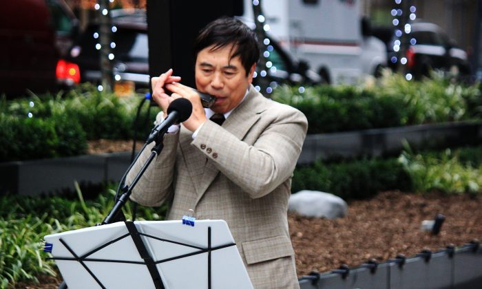 Harmonica virtuosos Jia-Yi He in a public performance for Sounds of the Season. (East Midtown Partnership)