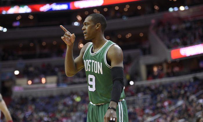 Boston Celtics guard Rajon Rondo (9) gestures during the first half of an NBA basketball game against the Washington Wizards, Monday, Dec. 8, 2014, in Washington. (AP Photo/Nick Wass)