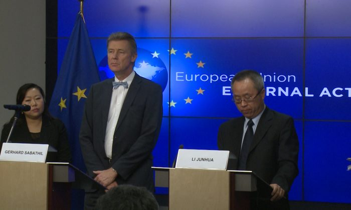 Gerhard Sabathil (L), director for East Asia and the Pacific in the European External Action Service (EEAS) and Li Junhua, director general for International Organizations and Conferences, Ministry of Foreign Affairs of the People's Republic of China hold a joint press conference after the 33rd human rights dialogue at the headquarters of the EEAS in Brussels on Dec. 8, 2014.