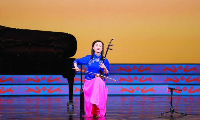 Soloist Xiaochun Qi plays the erhu, a traditional Chinese instrument during a performance by Shen Yun Performing Arts. Chinese medicine has long used music to treat ailments of mind, body, and spirit.