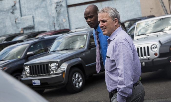 A customer shops at a Jeep dealership on Aug. 6 in New York City. (Andrew Burton/Getty Images)