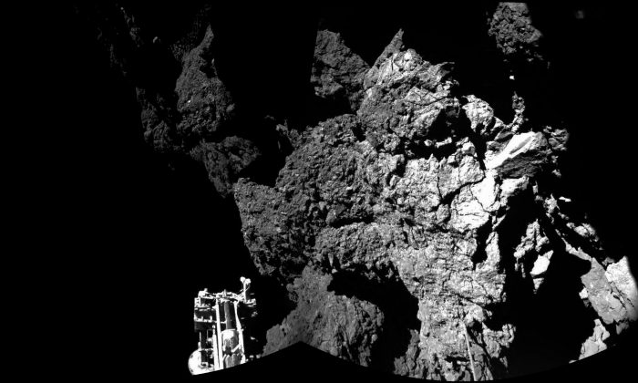 In this file photo dated Thursday Nov. 13, 2014, a combination photo produced with different images taken with the CIVA camera system released by the European Space Agency ESA, shows Rosetta's lander Philae after landing safely on the surface of Comet 67P/Churyumov-Gerasimenko,  as these first  CIVA images confirm. One of the lander's three feet can be seen in the foreground. Philae became the first spacecraft to land on a comet when it touched down Wednesday on the comet, 67P/Churyumov-Gerasimenko. (AP Photo/Esa/Rosetta/Philae, FILE)