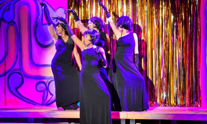 """""""Soul Nativity's"""" Girl Group performs a soul number reminiscent of the 70s, at the Harlem School of Arts, in Manhattan, N.Y. The cast engaged the audience to participate in singing many traditional hymns, which were pointedly sung in multiple languages and by choirs of varied ethnic backgrounds. (Steve Schnur)"""