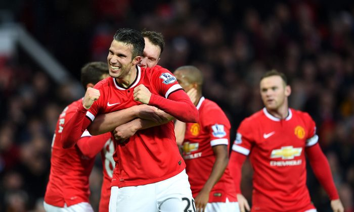Robin van Persie of Manchester United celebrates scoring the third goal during the Barclays Premier League match between Manchester United and Liverpool at Old Trafford in Manchester, England. (Shaun Botterill/Getty Images)