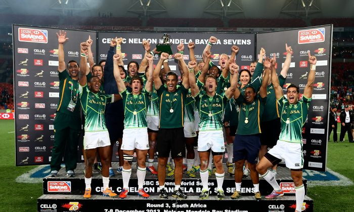Cup winners South Africa after the Cup Final between South Africa and New Zealand during day 2 of the Cell C Nelson Mandela Bay Sevens at Nelson Mandela Bay Stadium on December 08, 2013 in Port Elizabeth, South Africa. (Richard Huggard/Gallo Images/Getty Images)