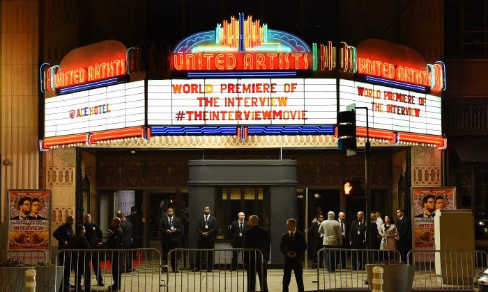 Security is seen outside The Theatre at Ace Hotel before the premiere of the film 'The Interview' in Los Angeles, California on December 11, 2014. Sony hackers have threatened the New York City premiere of the film with terrorism. (AFP/Getty Images)