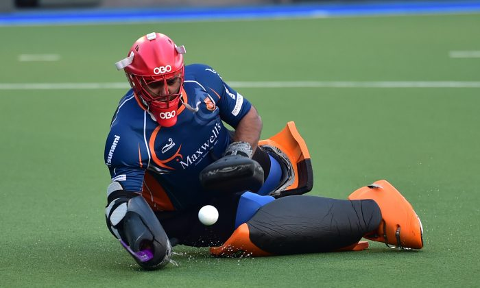 Khalsa-A's goalie made many important blocks and saves in their HKHA Premier Division match against Punjab-A at King's Park on Sunday Dec. 14, 2014. (Bill Cox/Epoch Times)
