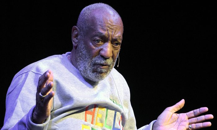 Bill Cosby performs during a show at the Maxwell C. King Center for the Performing Arts in Melbourne, Fla. (AP Photo/Phelan M. Ebenhack, File)