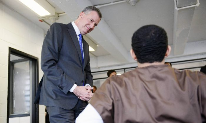 New York City mayor Bill de Blasio speaks with youth incarcerated at the Robert N. Davoren Center, a facility within the city's Rikers Island jail complex, during a visit on Wednesday, Dec. 17, 2014. (New York Daily News)