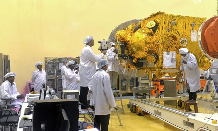 Scientists and engineers work on a Mars Orbiter vehicle at the Indian Space Research Organization's (ISRO) satellite center in Bangalore on Sept. 11, 2013. India is slowly increasing its technology in space, both for the civilian purposes and increasingly for military purposes. (Manjunath Kiran/AFP/Getty Images)