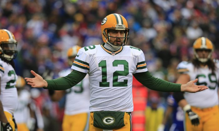 Aaron Rodgers, the Green Bay Packers quarterback, appeared to go down with a leg injury in the second quarter against the Detroit Lions on Sunday. Green Bay Packers quarterback Aaron Rodgers (12) gestures to the sidelines during the first quarter against the Buffalo Bills on Sunday, Dec. 14, 2014, in Orchard Park, N.Y.  (AP Photo/The Buffalo News, Harry Schull, Jr.)  TV OUT; MAGS OUT; MANDATORY CREDIT; BATAVIA DAILY NEWS OUT; DUNKIRK OBSERVER OUT; JAMESTOWN POST-JOURNAL OUT; LOCKPORT UNION-SUN JOURNAL OUT; NIAGARA GAZETTE OUT; OLEAN TIMES-HERALD OUT; SALAMANCA PRESS OUT; TONAWANDA NEWS OUT