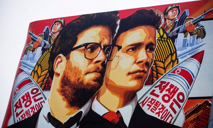 """A banner for """"The Interview"""" is posted outside Arclight Cinemas, Wednesday, Dec. 17, 2014, in the Hollywood section of Los Angeles. (AP Photo/Damian Dovarganes)"""