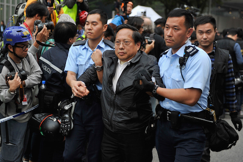 Legislator Albert Ho Chun-yan taken away by the cops during the Admiralty clearing. (Lucas Schifres/Getty Images)