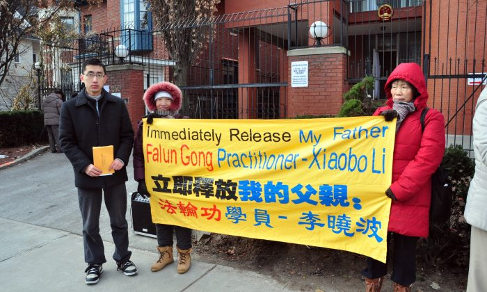 Canadian citizen Li Zhe, along with other Falun Gong practitioners, hold an event in front of the Chinese consulate in Toronto to seek the release of his father, Li Xiaobo, who has been detained since April 2014 in China for his belief in Falun Gong. During that time he has not been permitted any outside contact, including with a lawyer or family members. (Allen Zhou/Epoch Times)