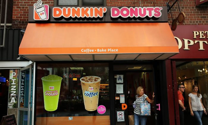 A woman walks out of a Dunkin' Donuts on July 25, 2013, in New York City. (Spencer Platt/Getty Images)