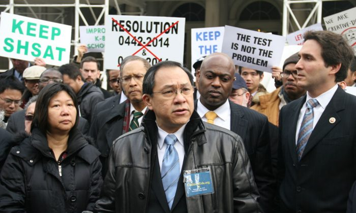 David Lee (C), 55, co-founder of a specialized high schools admissions exam advocacy group on the steps of City Hall in Manhattan, N.Y., on Dec. 11, 2014. (Shannon Liao/Epoch Times)