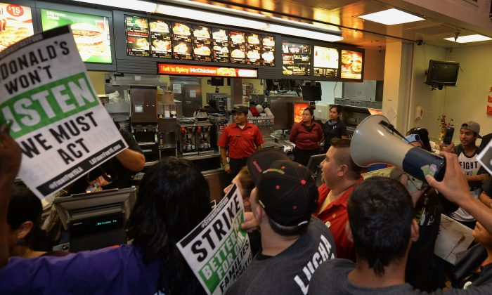Fast-food workers at a McDonald's restaurant during a demonstration against low wages in Los Angeles on Sept. 4. The National Labor Relation Board's decision on Friday will help fast-food workers unionize against the fast-food chain. (Mark Ralston/AFP/Getty Images)