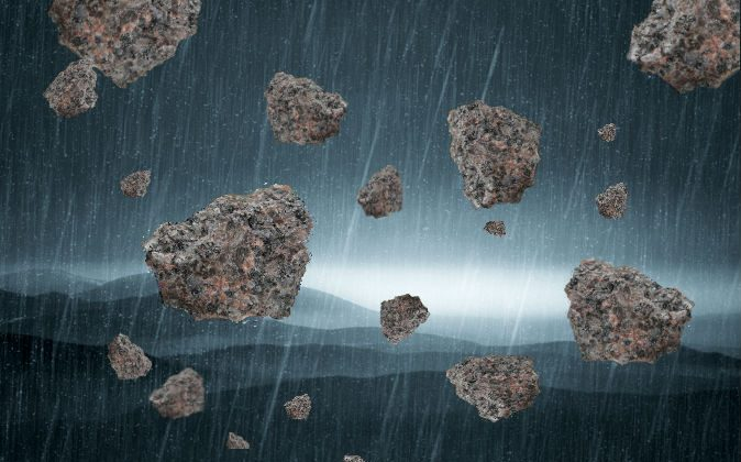 While high winds or tornadoes may explain how some objects (such as fish or frogs) have been swept up and rained down on the Earth, it seems unlikely that days-long rains of large stones can be explained this way. (Background via Shutterstock*)
