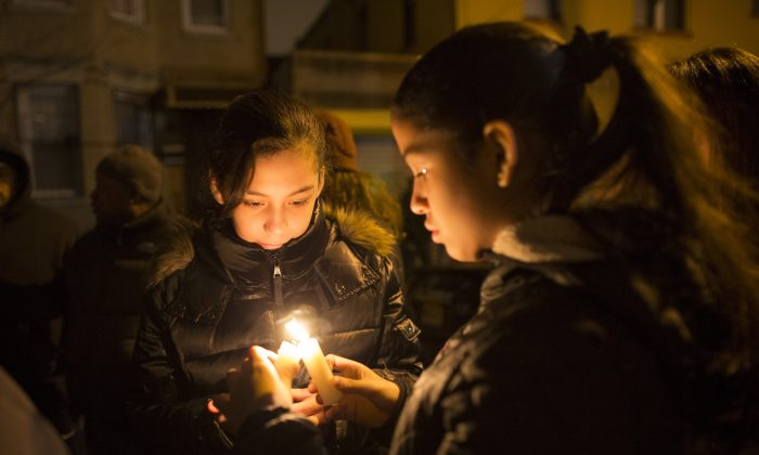 Angelica Tellez, 11, (L) and Angie Moronta, 11, attend a candlelight vigil in front of slain NYPD police officer Rafael Ramos's childhood home in Brooklyn on Dec. 21, 2014. (Michael Graae/Getty Images)