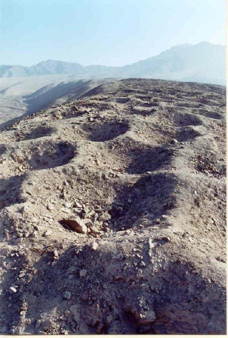 The mysterious holes of Pisco Valley, Peru. (Bruno7/Panramio, CC BY)