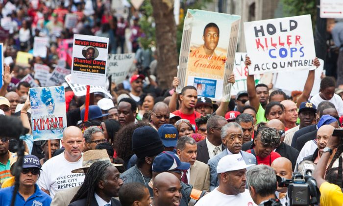 """A march on Staten Island Aug. 23 seeking justice for the death of Eric Garner, dubbed """"We Will Not Go Back."""" (Petr Svab/Epoch Times)"""