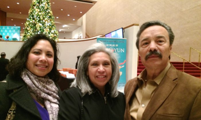 Mr. and Mrs. Garcia and their daughter (L) enjoy Shen Yun Performing Arts at Houston's Jones Hall, on Dec. 29, 2014. (June Fakkert/Epoch Times)