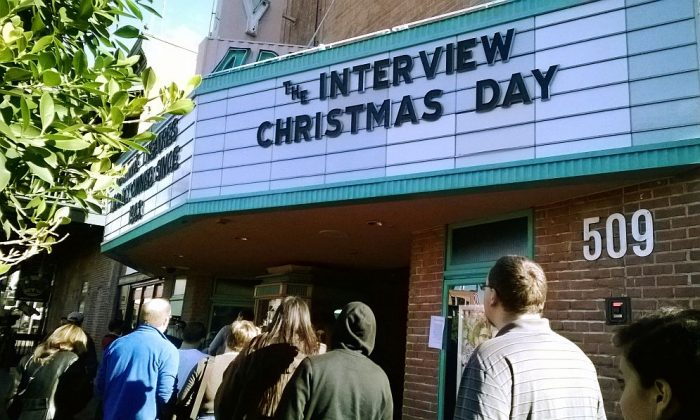 """Patrons wait in line to see """"The Interview"""" at the Valley Art theater in Tempe, Ariz., on Dec. 25. The FBI concluded that North Korea hacked Sony in retaliation for making """"The Interview,"""" which depicts the assassination of North Korean leader Kim Jong Un, but the security firm Norse said an ex-employee was the culprit. (AP Photo/Alina Hartounian)"""