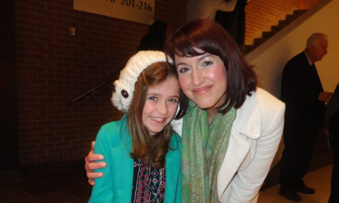 Mezzo-soprano Jennifer Centrone and her daughter, Paris, enjoyed Shen Yun Performing Arts at Centre In The Square in Kitchener, Canada on Dec. 30, 2014. (Madalina Hubert/Epoch Times)