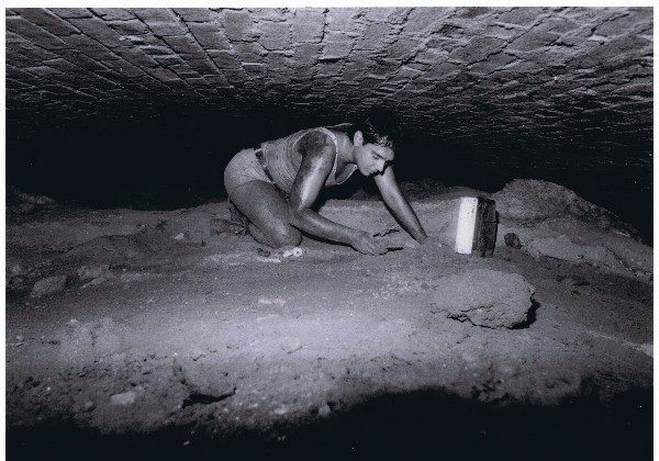 Robert Diamond rediscovering the tunnel entrance circa 1980. He gained entry into the tunnel's main chamber in 1981. (Courtesy of BHRA)