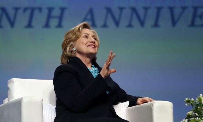 Former Secretary of State Hillary Rodham Clinton speaks in Boston on Dec. 4, 2014. (AP Photo/Elise Amendola)
