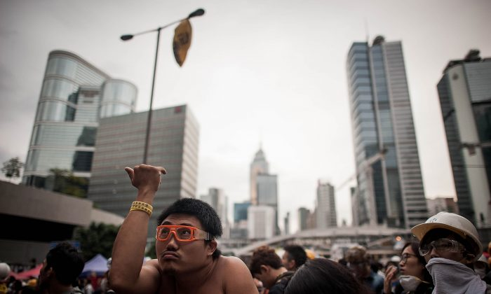 Eric the Shirtless Artist in Admiralty, Dec. 1. (Anthony Kwan/Getty Images)
